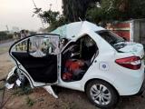 Four killed as car rams lorry