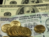 Rupee ends at 68.79 per dollar
